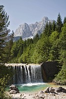 View across waterfall over weir on River Velika Pisnca to Prisank mountain, Triglav National Park, Julian Alps, Kranjska Gora, Dolina, Slovenia, Europ...
