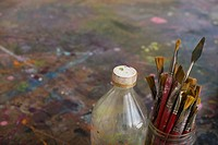 Artist's Paint Brushes and Bottle by Palette