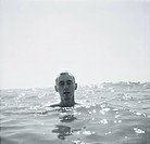 Man simmar i havet Close_Up Of Man Swimming In Sea