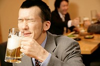 Man drinking beer in the Japanese_style pub