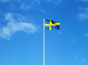 En Hissad Svensk Flagga Mot Blå Himmel, Swedish Flag, Low Angle View