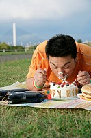 A man eating a cake