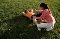 A couple making sit_ups