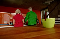 Senior couple standing in domestic kitchen