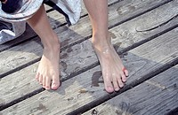 Barefooted Boy on a wooden Footbridge _ Swimming _ Youth