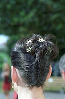 Dark_haired Woman with Flowers in her pinned up Hair _ Hairstyle _ Bride _ Wedding