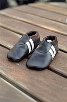 Leathery Children's Shoes on a wooden Underlay _ Clothing _ Childhood