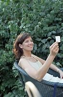 Brown_haired Woman looking at a Note _ Garden _ Festivity