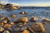 Rocks in a lake at sunset, East Shore, Lake Tahoe, Nevada, USA