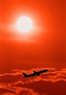 Flygplan I Solnedgång, Airplane In Flight At Sunset