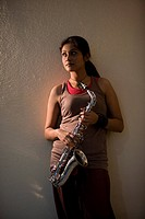 Woman holding a saxophone