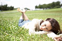 Young Woman Laying on Field