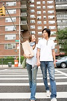 Young Couple Walking Down Street