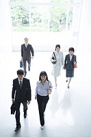 Business Scene, Five People Walking Through Office Building Lobby