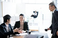 Business Scene, Three People at Meeting