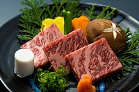 Slices of raw beef and vegetables on a plate, high angle view, close up, Japan