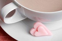 Heart shaped candies and latte close_up