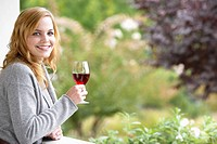 Young woman drinking red wine portrait (thumbnail)