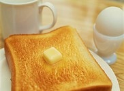 Bread, An Egg, And A Coffee Cup