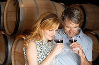 Couple smelling red wine