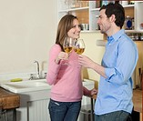 Mid_Adult Couple Toasting with White Wine