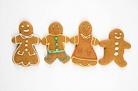 Gingerbread cookies holding hands