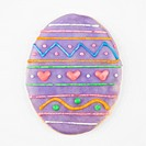 Sugar cookie in shape of Easter egg with decorative icing