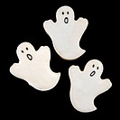 Three sugar cookies in shape of ghosts with decorative icing