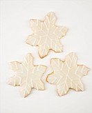 Three snowflake sugar cookies with decorative icing