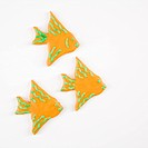 Three fish shaped sugar cookies with decorative icing