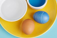 Two eggs by Easter egg dye close_up, directly above
