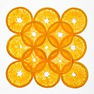 Orange slices arranged in square design on white background