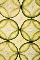 Lime slices arranged in design on white background (thumbnail)
