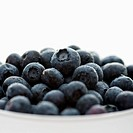 Bowl of blueberries against white background
