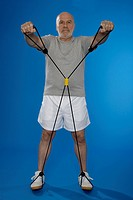Senior man exercising with resistance band