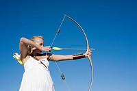 Young woman arrow shooting