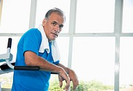 Mature man on exercise machine portrait
