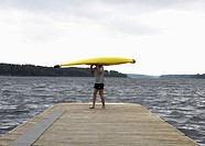 Woman Carrying Kayak on Her Head