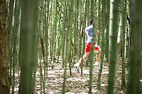 Young man jogging in forest