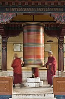 Buddhists turning prayer wheel, McLeod Ganj, Dharamsala, Himachal Pradesh state, India, Asia