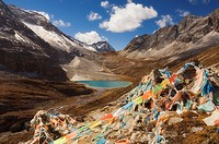 Prayer flags and Erongcuo Lake, Yading Nature Reserve, Sichuan Province, China, Asia