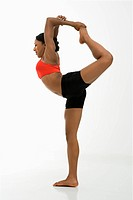 Profile of African American woman in Lord of the Dance Yoga position