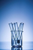 Test tubes in glass beaker with blue tint (thumbnail)