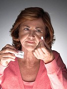 Mature woman taking aspirin