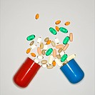 Container with spilt pills and vitamins