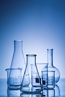 Glass science containers with blue tint.