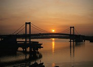 Rainbow Bridge And The Morning Sun In Tokyo