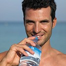 Man holding water bottle, close_up