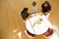 Family sitting around table, High Angle View