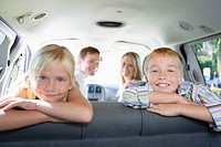 Portrait of family in car, smiling and looking at camera